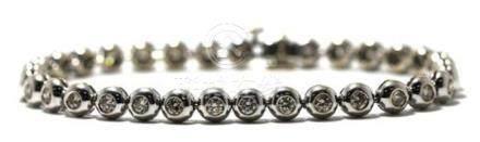 An 18ct White Gold Diamond Line Bracelet,