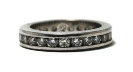 An 18ct White Gold Diamond All-round Band Ring,