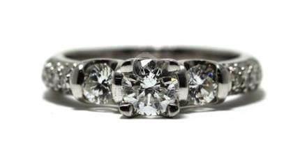 An 18ct White Gold Diamond Trilogy Ring,