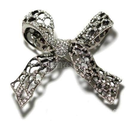 A Paspaley Platinum & Diamond Ribbon Brooch/ Swap Clasp,