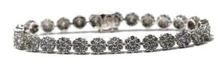 An 18ct White Gold Diamond Flower Line Bracelet,