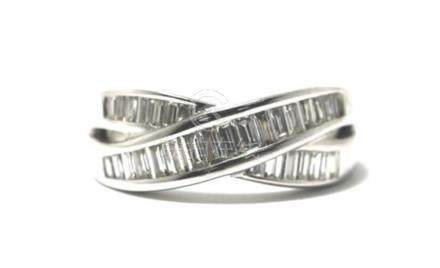An 18ct White Gold Baguette Diamond Cross-Over Band Ring,