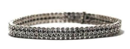 An 18ct White Gold Diamond Triple Row Line Bracelet,