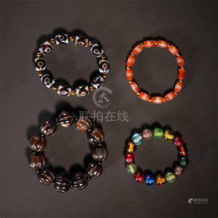 FOUR CHINESE AGATE BEAD BRACELET