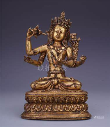CHINESE GILT BRONZE SEATED FOUR ARM GUANYIN