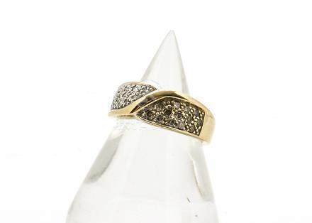 A 9ct gold diamond set dress ring, the pave set diamonds grouped in colour of cognac and white