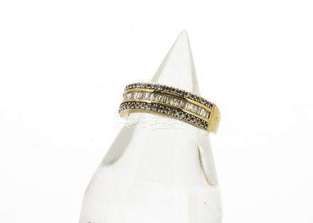 A 9ct gold diamond set half hoop eternity ring, the central channel set diamonds flanked by