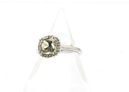 A 14ct gold zultanite and diamond dress ring, the cushion cut central stone within a band of