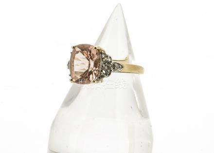 A 9ct gold morganite beryl and diamond dress ring, the oval mixed cut central stone in claw