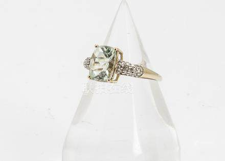 A 9ct gold amblygonite and diamond dress ring, the central rectangular mixed cut in four claw
