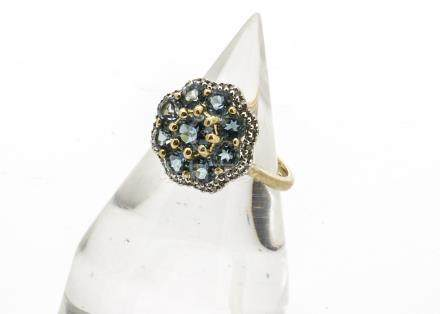 A 9ct gold topaz and diamond set dress ring, the flower setting with central circular cut topaz
