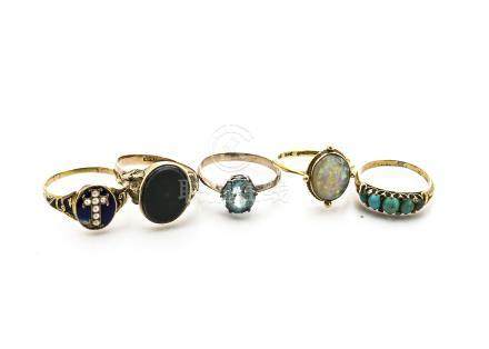 Five yellow metal gem set dress rings, comprising a 19th Century gold and enamel seed pearl set posy