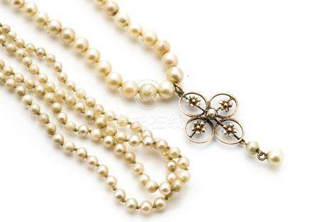 A cultured pearl graduated, knotted necklace, with stylised floral and yellow metal cruciform