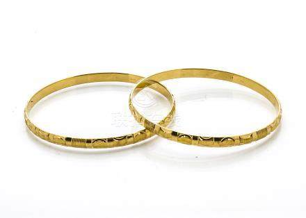 A pair of Indian yellow gold engine turned bangles, marked 916 to inner band, 6cm diameter, 34.8g