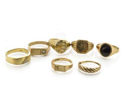 A collection of seven gold gentleman's rings, all 9ct gold, some set with cubic zirconia and onyx,