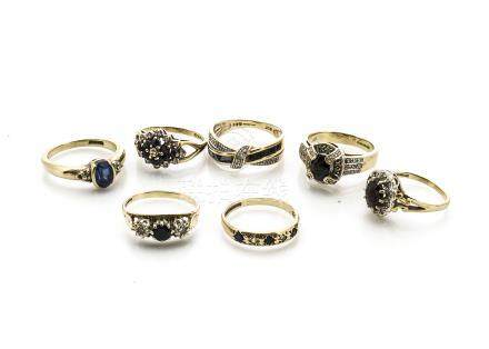 Seven 9ct sapphire set dress rings, some clusters, crossovers and dress rings, mostly set with small