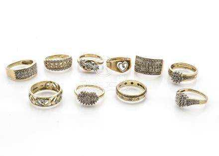Ten 9ct gold diamond set dress rings, including a puzzle ring, a three stone illusion set crossover,