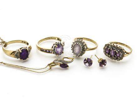 A collection of amethyst jewels, including four dress rings, a drop pendant with illusion set