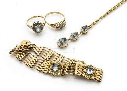 A 9ct gold padlock clasp gate bracelet, having three oval cut topaz to five bar linked chain, a