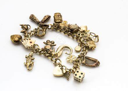A 9ct gold padlock clasp curb linked charm bracelet, with eighteen gold charms including dice, Irish