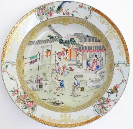 A large Chinese bowl with hand painted scenes of rural life, including a mother and child,