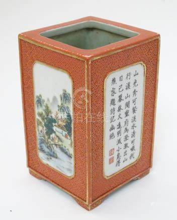 A 20thC Chinese brush pot of rectangular form, decorated with four panels with gilt highlights,