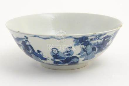 A 19thC Chinese blue and white bowl depicting figures in a landscape. Approx.