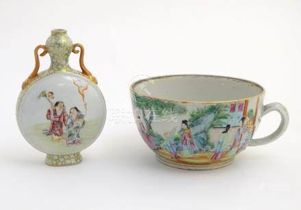 A Chinese twin handled moon vase decorated on one side with a lady and a frog,