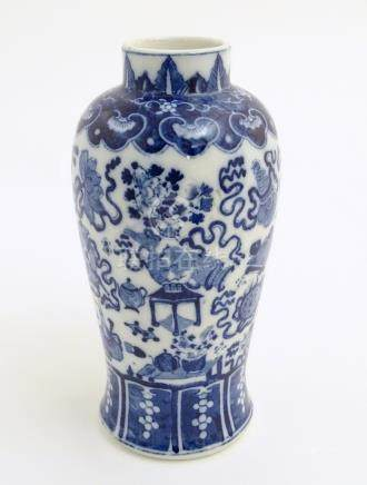 A Chinese blue and white vase decorated with emblems of good fortune,