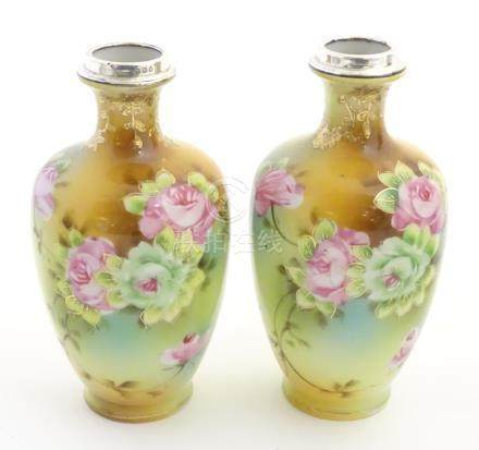 A pair of small Japanese baluster vases with hand painted floral decoration,