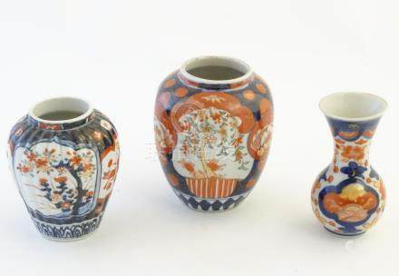 Three Imari vases decorated with panelled floral designs. Largest approx.