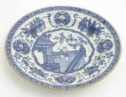 A 19thC Chinese blue and white dish, decorated with auspicious artifacts such as scrolls,