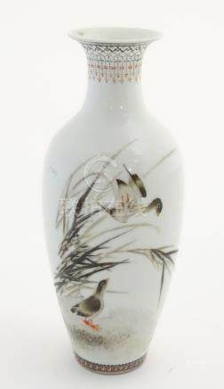 A small Oriental baluster vase, decorated with wader birds in reeds,