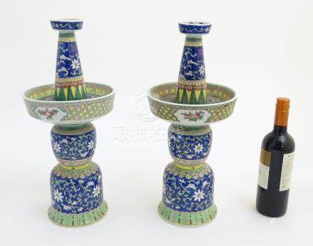 """A pair of two-sectional Chinese vases decorated with floral and foliate scrolls. Approx. 17 ¾"""" high."""