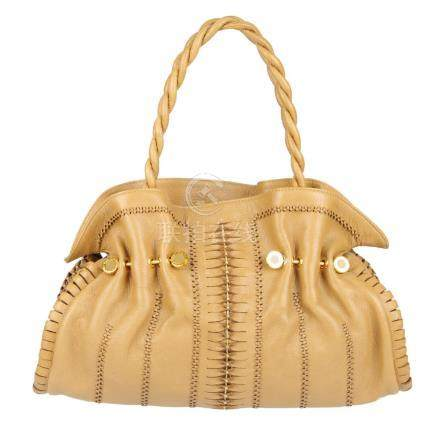 BULGARI - a ruched leather handbag. Crafted from tan