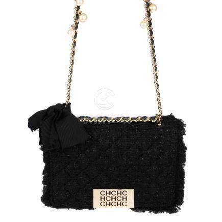 CAROLINE HERRERA - a black quilted tweed handbag.