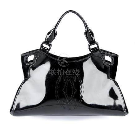 CARTIER - a black patent Marcello de Cartier handbag.