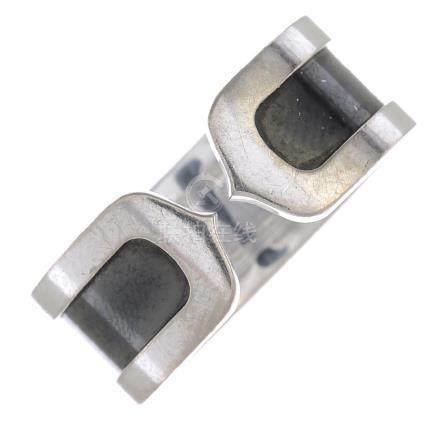CARTIER - an enamel 'C de Cartier' ring. Designed as an