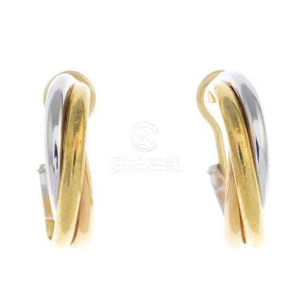 CARTIER - a pair of 'Trinity' earrings. Each designed