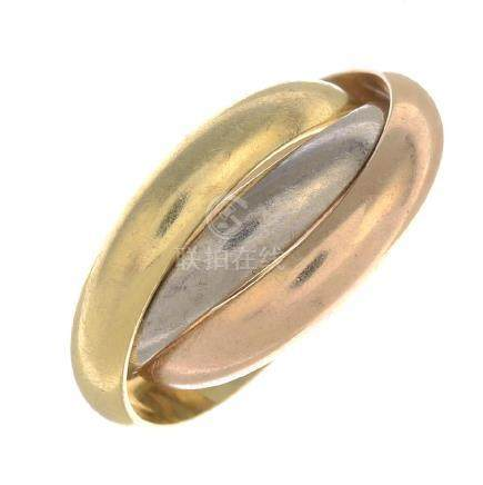 CARTIER - a 'Trinity' ring. Comprising three tri-colour
