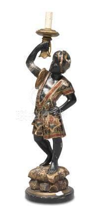 SCULPTURE OF A TORCHHOLDER MOOR, 19TH CENTURY in black, polychrome and gold lacquered wood. Measures