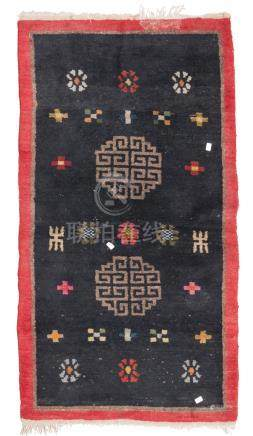 TIBETAN CARPET, EARLY 20TH CENTURY double meander medallion and secondary motifs of rosettes and