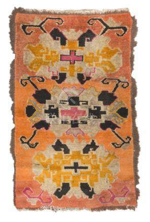 TIBETAN CARPET, 19TH CENTURY triple 'abstract' medallion with crosses and hooks, in the field on