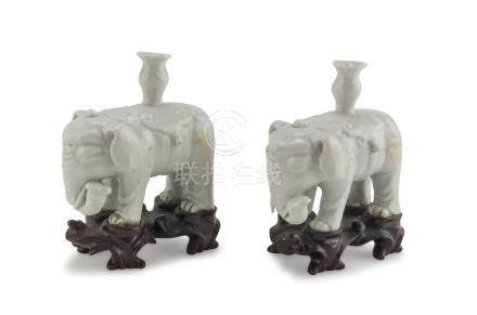 A PAIR OF CENSERS IN WHITE PORCELAIN, CHINA 20TH CENTURY representing two elephants with ritual