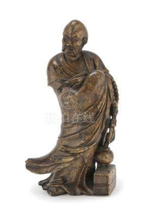 SCULPTURE IN SOAPSTONE, CHINA 19TH CENTURY representing a Lohan holding a big Buddhist rosary and