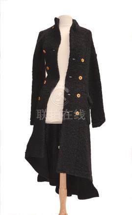 COMME DES GARCONS: Long pull noire en laine…