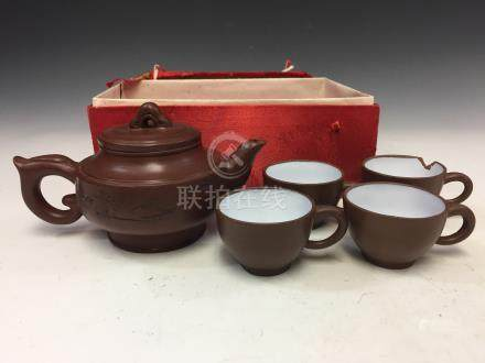 Set of Chinese Yixing teapot and four cups.