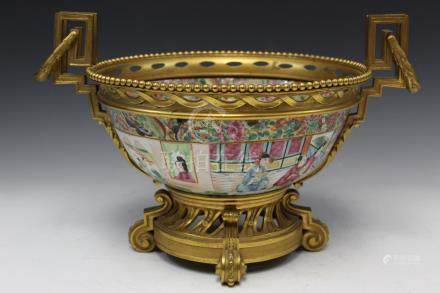 Chinese rose medallion porcelain bowl with brass mount.