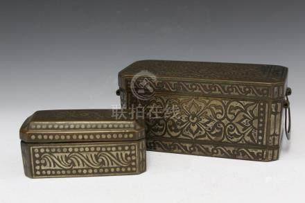 Two Islamic metal boxes.