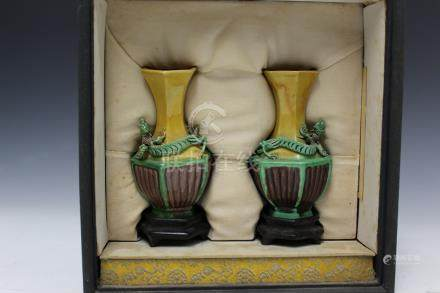 Pair of Chinese Sancai vases on wood stands in a box,